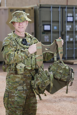 Australian Army officer Major Shane 'Buzz' Sarlin from Diggerworks with the 'Tiered Body-Armour System (TBAS) Tier 0 Heavy' harness (version 4.4) being trialled by soldiers from 6th Battalion, Royal Australian Regiment. Credit: Defence