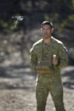 Australian Army soldier Corporal Matthew Molloy from 2nd/14th Light Horse Regiment (Queensland Mounted Infantry) with a PD-100 Black Hornet miniature unmanned aircraft vehicle at Gallipoli Barracks, Brisbane, on 5 October 2016.