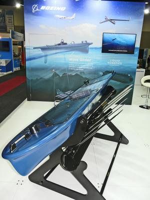 Boeing is also heavily invested in the unmanned maritime space – subsidiary Liquid Robotics was exhibiting its Wave Glider unmanned surface vehicle at Pacific 2017 on the Boeing stand. Credit: ADM Patrick Durrant