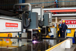 Sir Michael Fallon, UK Defence Secretary, cutting the first steel for the Royal Navy's first Type 26 frigate, the future HMS Glasgow, at BAE Systems ship facility at Govan on the Clyde. Credit: ADM Nigel Pittaway