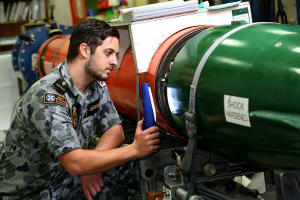 Able Seaman Aviation Technician Avionics Matthew Dockrill conducts a routine inspection between the after body and fuel cell of a MK48 Heavyweight torpedo in the Torpedo Maintenance Facility at the Navy Guided Weapons Systems Program Office-West on HMAS Stirling. Credit: Defence