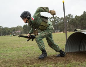 A soldier from the Singapore Army clears an obstacle during the Obstacle Course match at the 2017 Australian Army Skill At Arms Meeting, held at Puckapunyal, Victoria. 