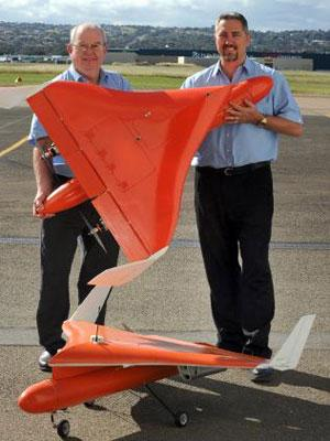 Mincham Aviation chief engineer Dave Betteridge (left) and managing director Darryl Mincham with the company's aerial sensor delivery system aircraft. [Image: Greg Higgs/The Advertiser]