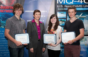 Three students at Dickson College in Canberra, Australia, were awarded scholarships by Northrop Grumman for their achievements in developing unmanned systems. Dickson College students, from left, are Noah Ingham, Amy Blunt and Jack Hubbard. Presenting the awards was Mary Petryszyn, vice president for International with Northrop Grumman Aerospace Systems.