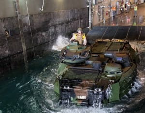 A United States Marine Corps Amphibious Assault Vehicle from USS San Diego 'swims' through the well dock of HMAS Canberra off the coast of Hawaii during Exercise Rim of the Pacific (RIMPAC) 2016.