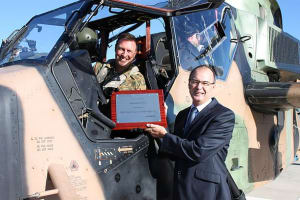 CO School of Army Aviation at OakeyLTCOL Dave Lynch and MD Airbus Group Australia Pacific Tony Fraser celebrate the 2000 hour milestone for the Tiger ARH. Credit: Airbus Helicopters