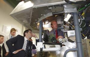 Defence Materiel minister, Jason Clare inspects the prototype turret assembly for the ASLAV Crew Procedural Trainer simulator project.