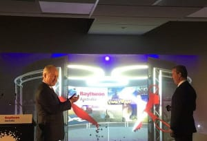 Raytheon Company CEO Tom Kennedy applauds as Defence Industry Minister virtually opens the CAVE at Raytheon's Customer Engagement Centre at the headquarters in Canberra. Credit: @Navantia_AU via Twitter