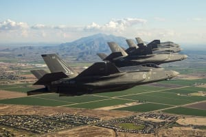 Four F-35A Lightning IIs, three US and one Australian jet (foreground), fly a training sortie recently near Luke Air Force Base, Arizona. The program surpassed the 50,000 flight hour mark in February. Credit: Lockheed Martin
