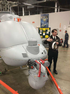 USN PMA program manager Capt Jeff Dodge with an MQ-8C Fire Scout variant at Pax River. Credit: ADM Katherine Ziesing