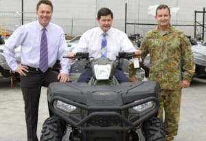 Polaris Australia's Managing Director Peter Alexander with The Hon Kevin Andrews MP Minister for Defence (on bike) and MAJGEN Paul McLachlan, Head of Land Operations Division DMO.