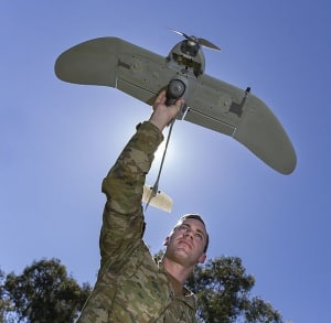 Army Corporal Doug Coombs from 2nd/14th Light Horse Regiment prepares to launch a Wasp AE small unmanned aircraft vehicle at Gallipoli Barracks, Brisbane.