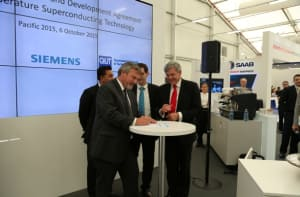 Dr Alex Zelinsky CEO DST Group signs the agreement with Siemens Australia CEO Jeff Connelly. Credit: Siemens Australia