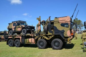 A Rheinmetall MAN truck on display with a Mercedes G-wagon during the handover ceremony. Credit: ADM (David Jones)