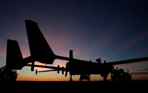 Heron RPA A45-253 out on the hardstand at dawn at the Woomera Test Range during pre-deployment training for personnel deploying to the Heron Detachment at Kandahar Airfield, Afghanistan in 2013. Credit: Defence