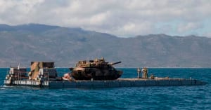 HMAS Choules' MEXEFLOTE landing raft transports an Abrams M1A1 main battle tank to the beach at Upstart Bay in Central Queensland as part of an amphibious landing rehearsal during Exercise Talisman Sabre 2017. Credit: Defence