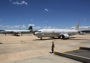 The old and the new. An AP-3C and the first of the aircraft that will replace it – the Boeing P-8A Poseidon at RAAF Fairbairn, Canberra. Credit: Defence