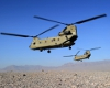 Two CH-47 Chinooks take off on a mission. [Photo:Defence]