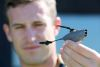 Australian Army soldier Lance Corporal David Sargeant, 6th Battalion, Royal Australian Regiment, holds the PD-100 Black Hornet Nano air vehicle. Credit: Defence