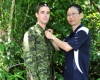 Private Taylor Gleeson has a Canadian uniform checked by Dr Bin Lee from the DSTO during the NATO camouflage effectiveness field trial at the Jungle Training Centre in Tully, Australia.