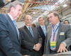 Gary Ervin (Northrup Grumman) and NSW Premier Barry O'Farrell with Quickstep's Philippe Odouard.