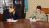 Kim Katheklakis of Jacobs Australia and BRIG Simon Stuart signing the contract. Credit: Defence