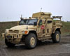 The Super Light Weight Roller system is installed on the front of a Navistar Defence Husky 4x4 protected vehicle