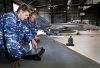 No. 6 Squadron aircraft technicians perform corrosion inspections on the wing of an F/A-18F Super Hornet at RAAF Base Amberley. The contract will see Boeing Defence Australia provide sustainment services for an initial five year period. Credit: Defence