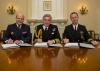 (L-R) ADM Christophe Prazuck Marine Nationale's Chief of Navy, ADM Sir Philip Jones, The First Sea Lord and Chief of Naval Staff, and Chief of Naval Operations ADM John Richardson sign the 2017 Trilateral Maritime Talks document at the Ministry of Defence in London. Credit: US Navy courtesy MOD