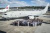 Dignitaries cheer the unveiling of the first of 12 Australian P-8A Poseidon aircraft at Boeing Field in Seattle. Credit: Defence