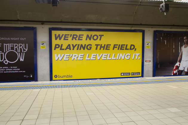 """We're not playing the field, we're leveling it,"" reads one of the Bumble billboards"