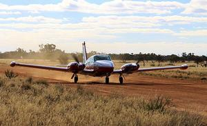The Comanche touches down on Bindara's natural strip. (Shelley Ross)