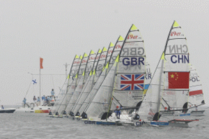 Tightly bunched 49er start for race seven.