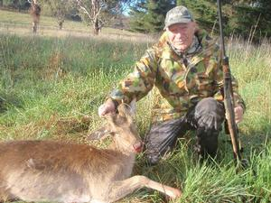 Robert with his first deer - and a first for the Bangor Boys