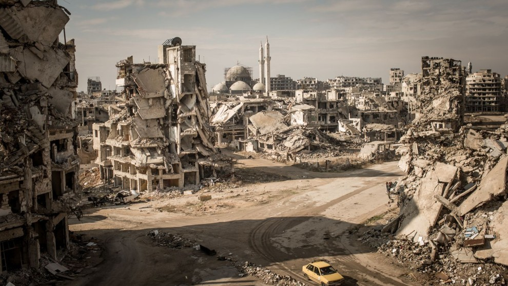3rd Place in Places. Photograph and caption by Christian Werner / 2018 National Geographic Photo Contest. While on assignment for Der Spiegel, we made a road trip through Syria to document the current situation in major cities. When I first entered the Khalidiya district in Homs, I was shocked. I hadn't seen such large-scale destruction before, and I had been to many destroyed cities. The area around the Khalidiya district was extremely quiet. No city sounds, cars—nothing. Only the chirping of swallows and the wind.