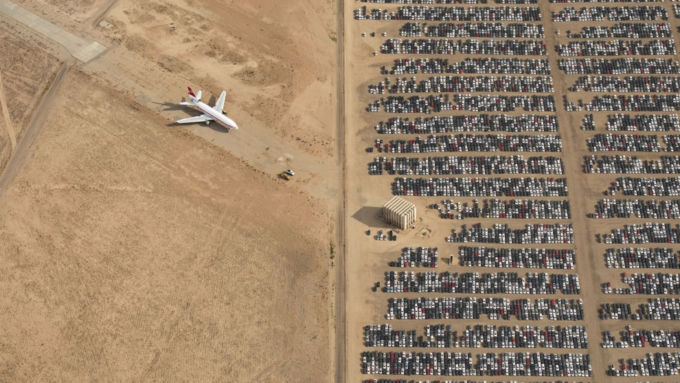 Overall winner, Jassen Todorov. Thousands of Volkswagen and Audi cars sit idle in the middle of California's Mojave Desert. Models manufactured from 2009 to 2015 were designed to cheat emissions tests mandated by the U.S. Environmental Protection Agency. Following the scandal, Volkswagen recalled millions of cars. By capturing scenes like this one, I hope we will all become more conscious of and more caring toward our beautiful planet.