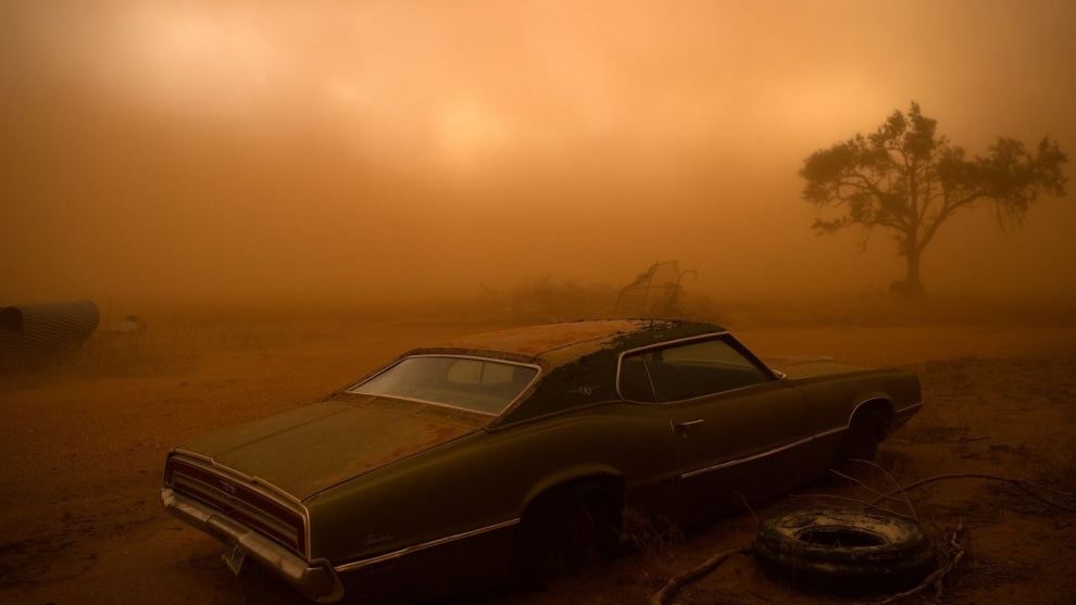 2nd Place in Places. Photograph and caption by Nicholas Moir / 2018 National Geographic Photo Contest. A rusting Ford Thunderbird is blanketed by red dust from a supercell thunderstorm in Ralls, Texas. The dry, plowed fields of the Texas Panhandle made easy prey for the storm, which had winds over 90 miles an hour ripping up the topsoil and depositing it farther south. I was forecasting and positioning a team of videographers and photographers on a storm chase in Tornado Alley—this was our last day of a very successful chase, having witnessed 16 tornadoes over 10 days. The target area for a storm initiation was just south of Amarillo, Texas. Once the storm became a supercell, it moved southbound with outflow winds that were easily strong enough to tear up the topsoil and send it into the air.