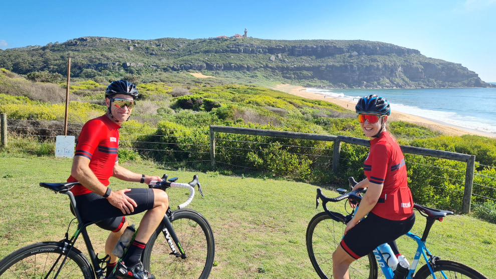 Bicycling Australia Black Sheep kit ambassadors Aiden and Sarah near Barrenjoey Lighthouse at Palm Beach North of Sydney.