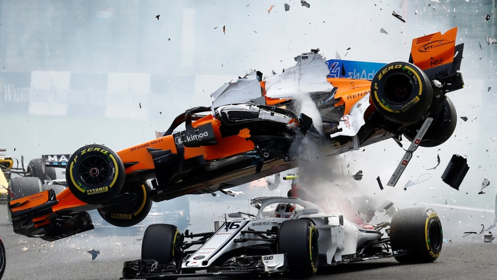 Copyright: © Francois Lenoir, Belgium, Shortlist, Open, Motion (Open competition), 2019 Sony World Photography Awards. McLaren's Fernando Alonso and Sauber's Charles Leclerc crash at the first corner during the Belgian Grand Prix in Spa-Francorchamps, Belgium, August 26, 2018.