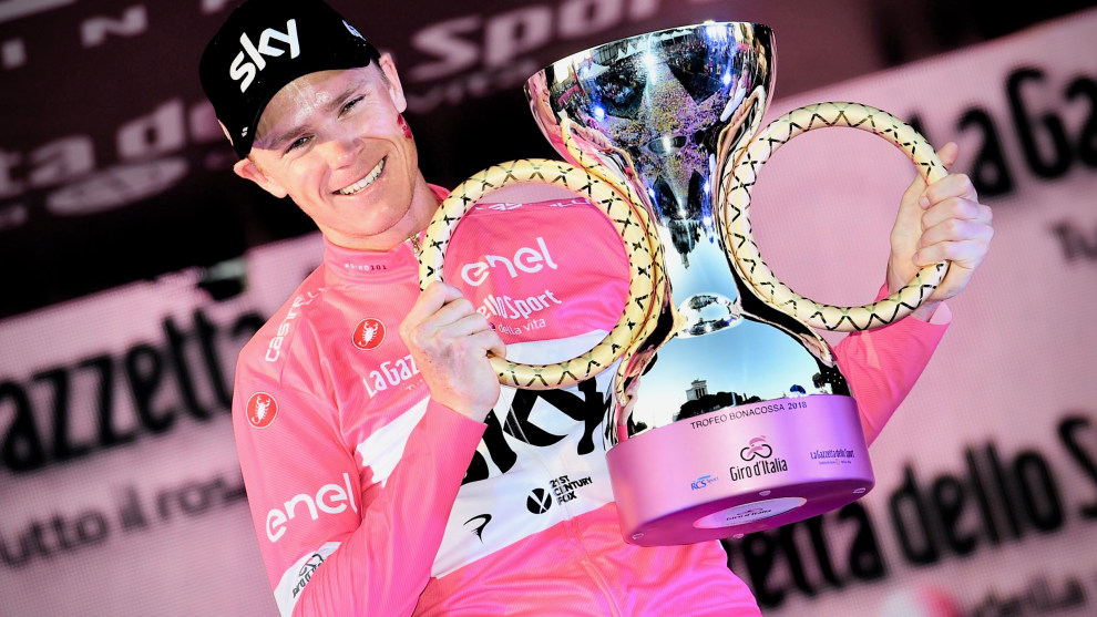 Froome with the spoils of his toil, the Team Sky rider on the podium after winning the 2018 Giro 'd Italia, his third successive Grand Tour victory. Image: Sirotti.