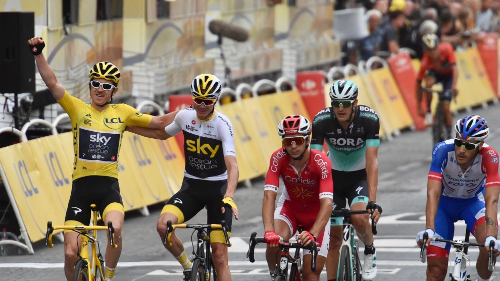 Geraint Thomas and Chris Froome celebrate as they cross the Stage 21 finish line at the 2018 Tour de France. Image: Sirotti