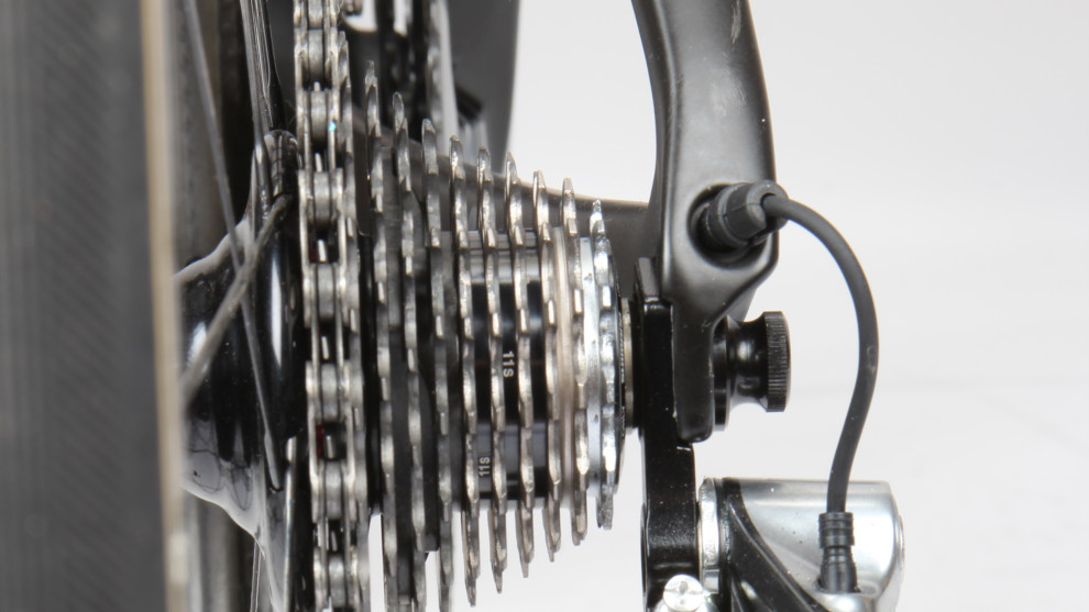 If you ever crash or drop the bike, always inspect the rear derailleur afterwards. The cage should run straight up and down, lining up with the cogs on the cassette. Slowly turn the pedals over and shift into the biggest cog. Check that you can't 'overshift' and put the chain into the spokes. If this happens the gears need adjusting or the derailleur/hanger is bent.