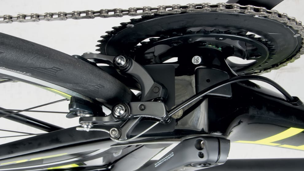 The low position of the rear brake is intended to cut drag, however it can interfere with some crank based power meters and is subject to more road debris than a bridge mounted caliper.