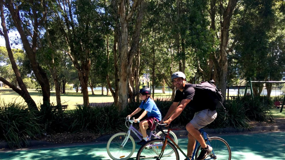 Dion and daughter Maia cycle along a section of the Cooks River Cycle Way near Canterbury.