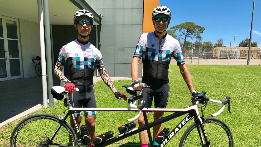 Totally blind cyclist Simon Wong with pilot Steve Hampton at a masters racing event in Adelaide.