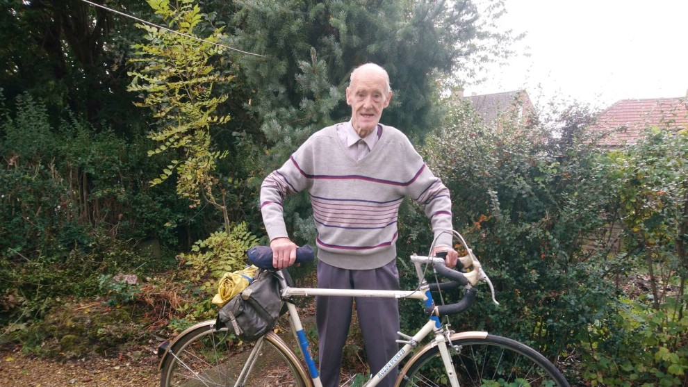 Russ Mantle stands with his trusty Holdsworth, which he has had since the 1960s and mended at least once, in his garden in Aldershot, Hampshire, October 2019.
