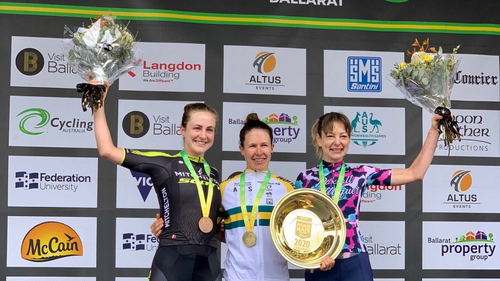 Amanda Spratt on the podium with Justine Barrow and Grace Brown.