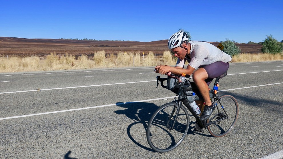 Lead IPWR rider Abdullah Zeinab averaged 30kph between Port Augusta and the town of Clare on the day we spoke with him. Here he is approx. 20km north of Clare. Image: Nat Bromhead