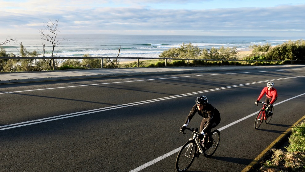 Two riders enjoy and early morning coastal ride along the David Low Way south of Noosa. Image: Nat Bromhead.