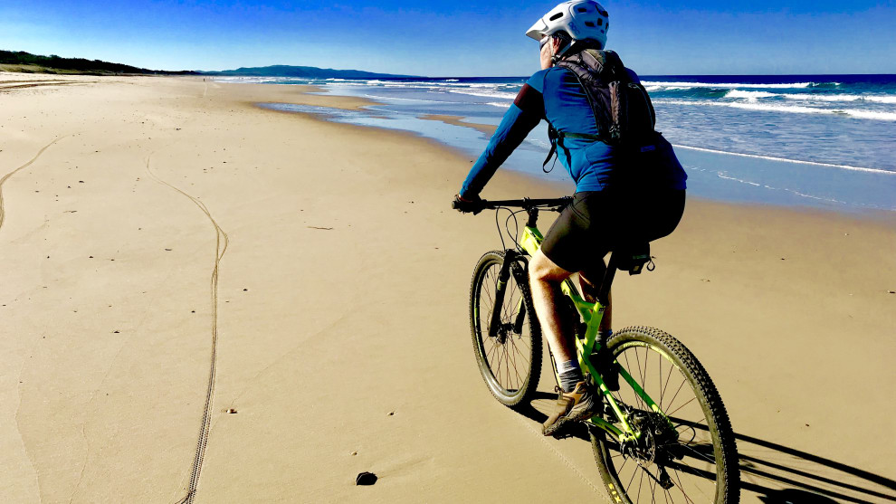 Mountain biking on the beach north of Noosa - one of the region's unique and spectacular drawcards.
